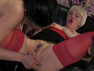 Steaming sexy mamma showing youthful cutie her skills during the time that dildoing palatable twat