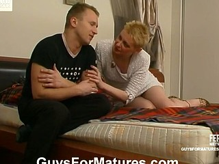 Lascivious older playgirl showing to desirous guy how it is required to fuck her